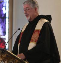 Reverend Enright at podium