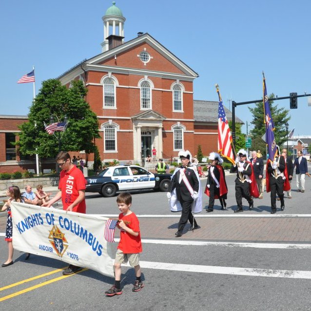 Knights of Columbus color corps with banner in parade