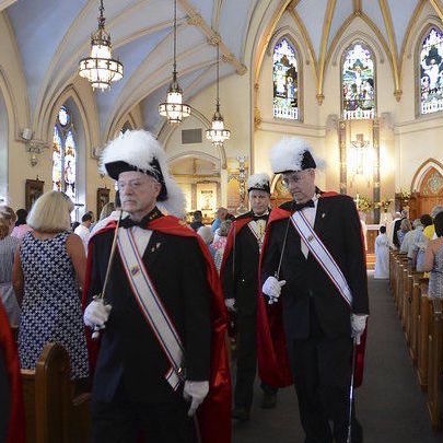 Knights in full dress uniform in church of St. Augustine
